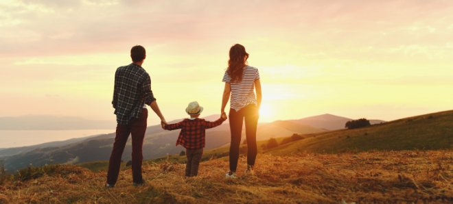 Happy family watching sunset with improved mental health and family dynamics after therapy with Valley Counseling Center in Mechanicsburg, PA