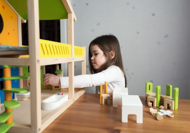 Child with trouble adjusting in play therapy session to help anxiety and social skills in central Pennsylvania