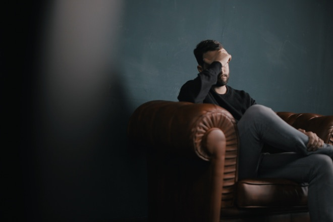 Man struggling with work stress and depression seeking counseling with VCC in Mechanicsburg, PA